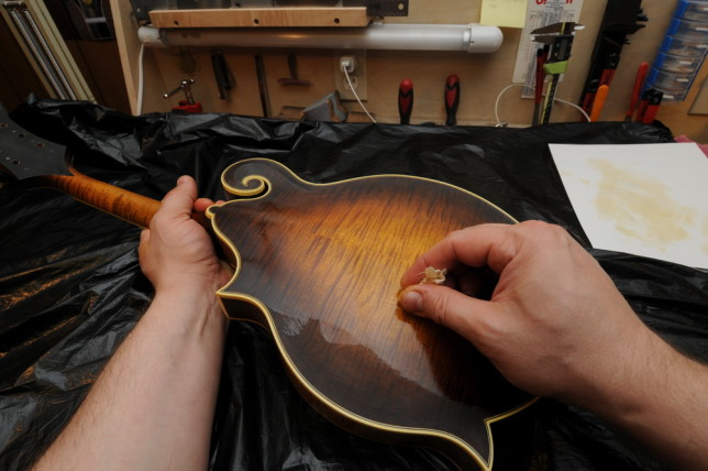 The process is repeated several times. Placing the Varnish by spraying, Scuffing it, followed by french polishing.